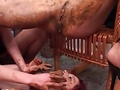 Brunette and redhead eating and spreading nasty scat together