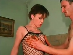 Dirty whore in black fishnet playing with hot brown scat