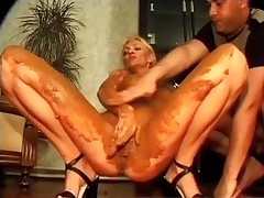 Clothed chubby guy shitting on this naked glamorous blonde whore