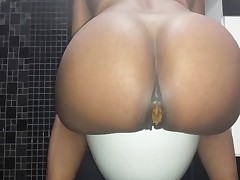 Look how this hot black booty squeezing a huge dose of hot shit