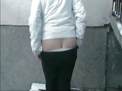 Extremely perverted babe shitting outdoors in the public place