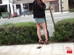 Long-legged Asian whore shitting outdoors in front intense car traffic