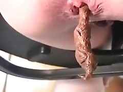Watch how babe defecating a tiny little flow of brown scat