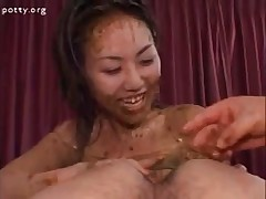 Asian whore is shitting very hot just to spread it on her face