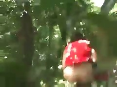 Asian cheerleader shitting in the woods and walking away