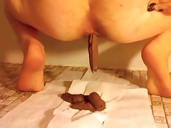 Sexy woman defecating floor and wiping her very dirty asshole