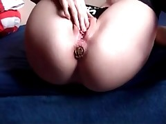 Scat-loving whore masturbating her tight anal with pleasure during shitting